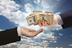 photodune-575727-handing-over-cash-with-dramatic-clouds-and-sky-xs-300x199
